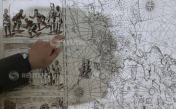 "A shadow of Filipino businessman Mel Velarde is cast upon a replica of a 1734 map he bought at an auction in London, which shows the Scarborough Shoal as part of the Philippine territory under Spanish rule during a Reuters interview in Manila June 19, 2015. A nearly 300-year-old map of the Philippines showing islands in disputed waters hopes to boost the country's claim in the South China Sea, Velarde said on Tuesday. The map, published in 1734 by Spanish priest Pedro Murillo Veralde, showed Scarborough Shoal, located around 124 nautical miles from the island of Luzon and labeled as ""Panacot"" in the map , as part of the Philippines territory. The original map was still in London for safekeeping, but a certified true copy was submitted to the Philippine government when it requested copies of historical maps for its UN arbitration case against China in The Hague.   REUTERS/Romeo Ranoco"